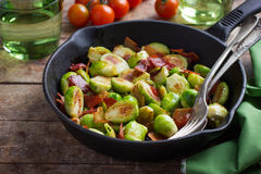 Roasted brussels sprouts with bacon. Selective focus royalty free stock photography
