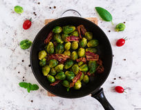 Roasted brussels sprouts with bacon on white background. Top view Royalty Free Stock Images