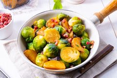 Roasted Brussels sprouts with honey and sesame from the oven. A Roasted Brussels sprouts with honey and sesame from the oven stock images