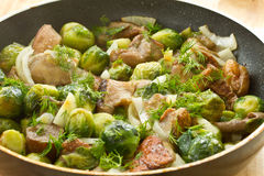 Roasted brussels sprouts and mushrooms Stock Photo