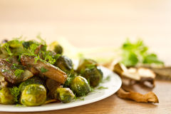 Roasted brussels sprouts and mushrooms Stock Photography