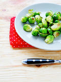 Roasted brussels sprouts on a plate Royalty Free Stock Photos