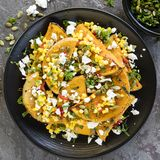 Roasted Butternut Squash or Pumpkin with Sweetcorn Salsa Feta and Pepitas stock image