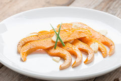 Roasted butternut squash slices and garlic. Royalty Free Stock Photo