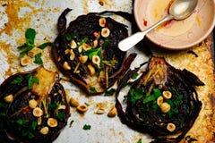 Roasted cabbage steaks with hazelnut dressing Stock Photo