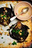 Roasted cabbage steaks with hazelnut dressing Royalty Free Stock Photography