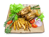 Roasted carcass woodcock with potatoes and vegetables on the pla Royalty Free Stock Photo