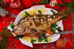 Roasted carp stuffed with vegetables for christmas stock image