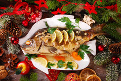 Roasted carp stuffed with vegetables for christmas Royalty Free Stock Images