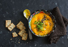 Roasted carrot and turmeric soup on a dark background Royalty Free Stock Photo