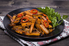 Roasted carrots in black plate, close up Stock Image