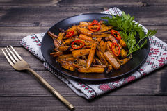 Roasted carrots in black plate, close up Royalty Free Stock Photos