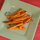 Roasted Carrots with Garlic and Olive Oil. Cooking with carrots and olive oil, a healthy meal Stock Photos
