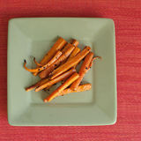 Roasted Carrots with Garlic and Olive Oil. Cooking with carrots and olive oil, a healthy meal Royalty Free Stock Images