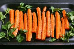 Roasted carrots with parsley Stock Images