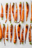 Roasted carrots with sauce stock photos