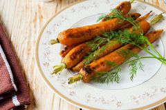 Roasted carrots with tails Royalty Free Stock Images
