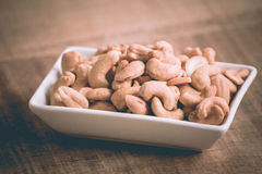 Roasted cashew nuts on wooden background Royalty Free Stock Photo