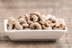 Roasted cashew nuts on wooden background,Vintage tone filter Royalty Free Stock Photos