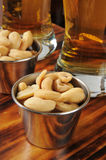 Roasted cashews and beer Stock Photo