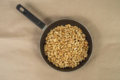 Roasted cashews in frying pan Stock Photo