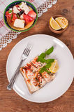 Roasted catfish fish meal with lemon in a white plate Royalty Free Stock Images