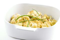 Roasted cauliflower. A nice replacement for mashed potatoes, and browned butter topped with crushed garlic and cheese croutons garnished with chives are a Stock Photos