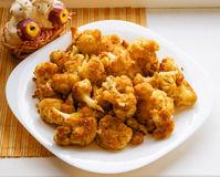 Roasted cauliflower in breadcrumbs. On white plate Royalty Free Stock Photography