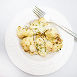 Roasted cauliflower. With garlic on a plate with fork Stock Images