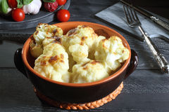 Roasted Cauliflower. Cauliflower roasted in rustic ceramic on gray background royalty free stock images