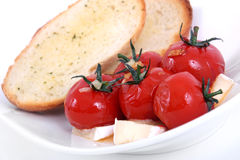 Roasted cherry tomato antipasto. With bread royalty free stock images
