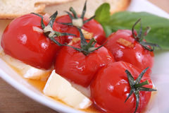 Roasted cherry tomato antipasto. With bread stock images
