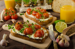 Roasted Cherry Tomato Sauce and Ricotta on Toast Stock Photo