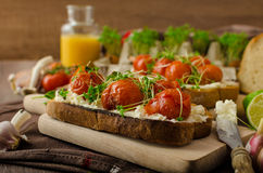 Roasted Cherry Tomato Sauce and Ricotta on Toast Royalty Free Stock Photography