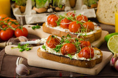 Roasted Cherry Tomato Sauce and Ricotta on Toast Stock Photos