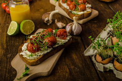 Roasted Cherry Tomato Sauce and Ricotta on Toast Royalty Free Stock Images