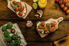 Roasted Cherry Tomato Sauce and Ricotta on Toast Stock Images