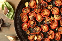 Roasted cherry tomatoes with garlic and herbs Royalty Free Stock Photography