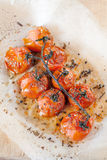 Roasted cherry tomatoes with herbs Royalty Free Stock Image