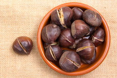 Roasted chestnuts in bowl from above Stock Image
