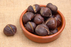 Roasted chestnuts in bowl Stock Images