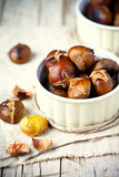 Roasted chestnuts in bowls Stock Photo