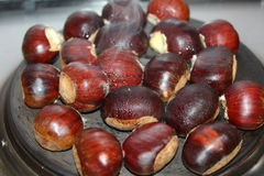 Roasted chestnuts stock photography