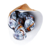 Roasted chestnuts in a craft paper bag isolated on white backgro Royalty Free Stock Photography