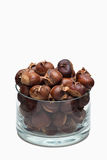 Roasted chestnuts in a glass dish. Isolated in white Stock Image
