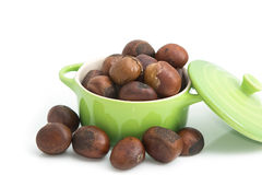 Roasted chestnuts in green bowl Stock Images