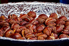 Roasted chestnuts in a large bowl Stock Photo