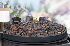 Roasted chestnuts with the measuring cup Stock Images