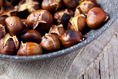 Roasted chestnuts in a pan Stock Image