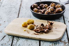 Roasted chestnuts in the pan Royalty Free Stock Images